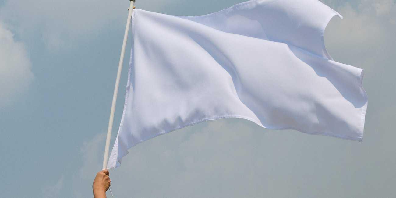Hand up holding white flag